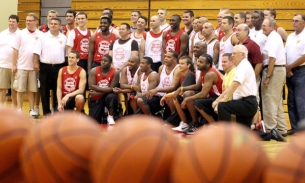 Jeff Krage ñ For the Kane County Chronicle<br /> Former Batavia basketball players and coaches pose for a picture inside the Batavia High School gymnasium before Saturday's benefit game honoring the late Michael Newman, a former player who died in November. <br /> Batavia 7/14/12