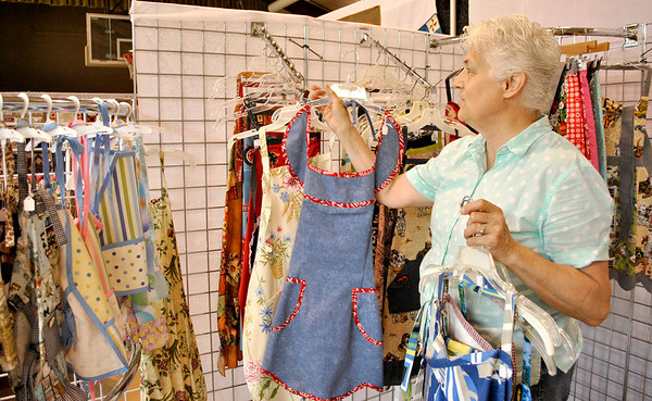 Joan Vidlak of Maple Park sets up her booth at the Batavia Depot Museum's sixth annual quilt and textile show.