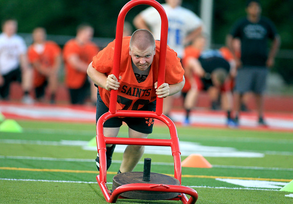 Cullen Cady of St. Charles East competes in a push pull sled relay, which was part of a 7-on-7 football challenge featuring Geneva, St. Charles East, St. Charles North and Batavia, at Mooseheart Friday night.