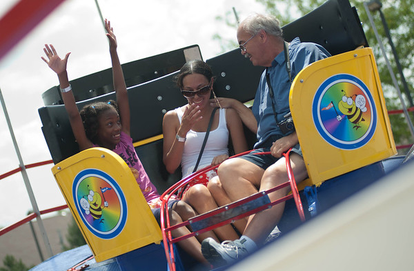 Geneva resident Gregg Glaber, on right, spins in the Tilt-A-Whirl ride at Windmill Days with Charron Davis, center, and Destinee Davis, left, Sunday afternoon in Batavia.