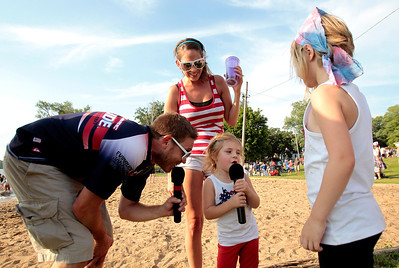 Kyle Grillot - kgrillot@shawmedia.com  Brynnlee Shulda, 2, (center) says a few words to the crowd with the Wonder Lake Water Ski Team announcer Adam Treasure (left) Shaleigh Fallaw, (center-rear), and Kari Webb, 7, after the end of the Wonder Lake 4th of July Water Ski Show at Center Beach.