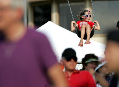 Kyle Grillot - kgrillot@shawmedia.com  Samantha Andersen, 6, of McHenry swings above the crowds during the Wonder Lake 4th of July Water Ski Show at Center Beach.