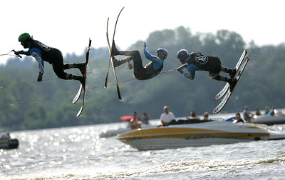Kyle Grillot - kgrillot@shawmedia.com  Wonder Lake Ski Team members do flips off a ramp during the Wonder Lake 4th of July Water Ski Show at Center Beach on East Lake Shore Drive.