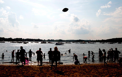 Kyle Grillot - kgrillot@shawmedia.com  The crowd takes to the beach during an intermission of the Wonder Lake 4th of July Water Ski Show at Center Beach.