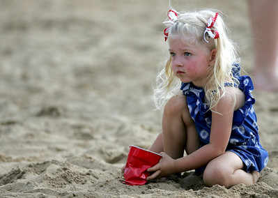 Kyle Grillot - kgrillot@shawmedia.com  Skylar Rishling, 3, of Wonder Lake plays in the sand towards the end of the Wonder Lake 4th of July Water Ski Show at Center Beach.