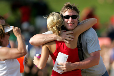 Kyle Grillot - kgrillot@shawmedia.com  Patrick Scully (right) hugs Kristy Hurckles, both of Wonder Lake after winning a raffle prize during the Wonder Lake 4th of July Water Ski Show at Center Beach.