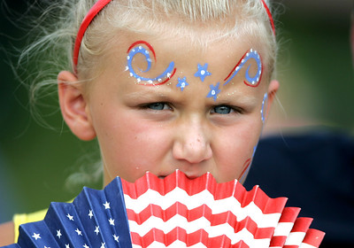 Kyle Grillot - kgrillot@shawmedia.com  Adriana Gerstung, 6, watches the Wonder Lake Ski Team from the beach during the Wonder Lake 4th of July Water Ski Show at Center Beach on East Lake Shore Drive.