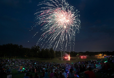Kyle Grillot - kgrillot@shawmedia.com  Fireworks explode near Emricson Park to celebrate the fourth of July in Woodstock.
