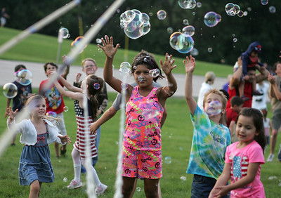 Kyle Grillot - kgrillot@shawmedia.com  Children play with bubbles at Emricson Park while celebrating the fourth of July in Woodstock.