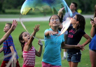 Kyle Grillot - kgrillot@shawmedia.com  Samantha Vences, and Elizabeth Sanchez play with bubbles at Emricson Park while celebrating the fourth of July in Woodstock.