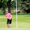 Luke Molloy of Wayne hits onto the 12th green during the Illinois Junior Golf Association Jarvis Memorial Tournament at Cress Creek Country Club in Naperville Monday morning.