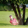 Andrew Sherman of St. Charles hits onto the 15th green during the Illinois Junior Golf Association Jarvis Memorial Tournament at Cress Creek Country Club in Naperville Monday morning.