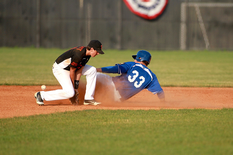 Anthony Bragg (33) of  St. Charles American Legion Post 342 slides safely into second base during their game against Hampshire Post 680 at St. Charles North High School Tuesday.