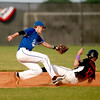Mitch Endriukaitis of  St. Charles American Legion Post 342 gets a player out at second during their game against Hampshire Post 680 at St. Charles North High School Tuesday.