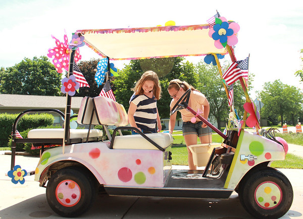 Alyssa McCannon, 15, (right) and Sammie McCannon, 11, of Sugar Grove wash their grandmother's car, JoJo the Clown, Thursday.