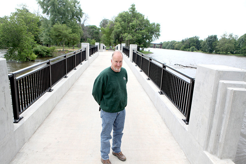 Larry Gabriel, Geneva superintendent of parks and properties for the City of Geneva, stands on the new Island Park North Bridge which was named after him at a dedication ceremony on Saturday.  Gabriel oversaw the whole project to replace the bridge, starting in 2004.