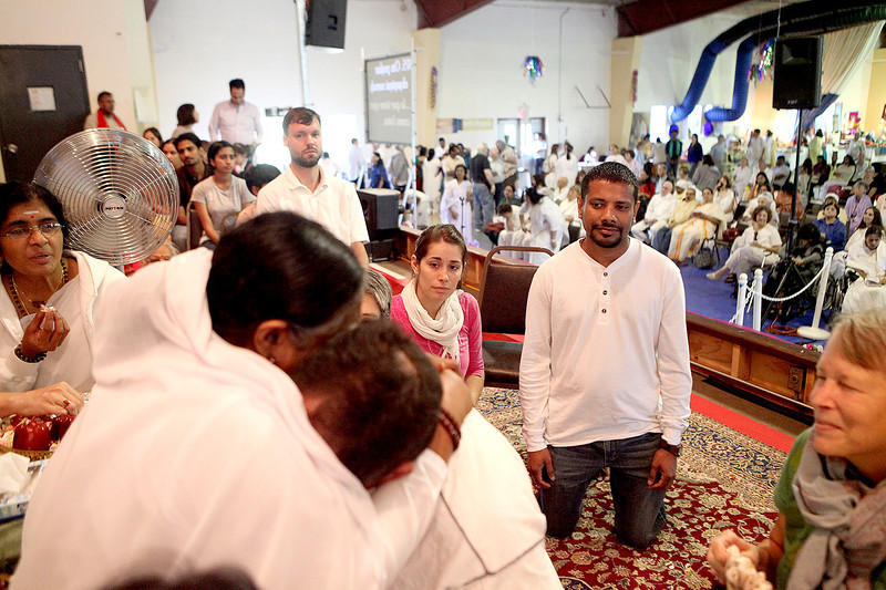 """Hindu spiritual leader Sri Mata Amritanandamayi Devi, known to many as """"The Hugging Saint,"""" or simply as """"Mother"""" to others, visits with guests at the M.A. Center Chicago, a religious center that bears her name in LaFox Friday."""
