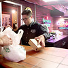 Gino's East manager Edward Pignataro packs up a take-out order during lunchtime at the St. Charles restaurant, which is located on Route 64.