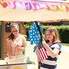 Alyssa McCannon, 15, (left) and Sammie McCannon, 11, of Sugar Grove wash their grandmother's car, JoJo the Clown, Thursday.