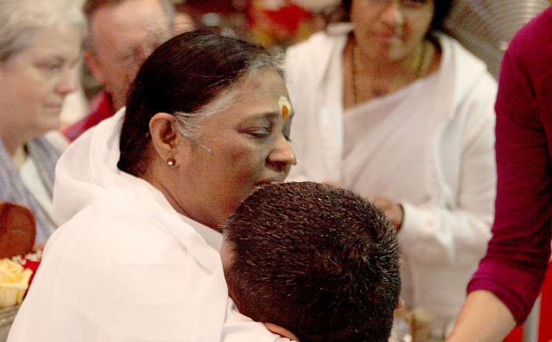 "Hindu spiritual leader Sri Mata Amritanandamayi Devi, known to many as ""The Hugging Saint,"" or simply as ""Mother"" to others, visits with guests at the M.A. Center Chicago, a religious center that bears her name in LaFox Friday."