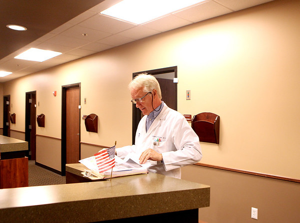 Dr. Norbert Becker looks over a patient's file at the Geneva Eye Clinic. The Geneva Eye Clinic has become a partner with the Foundation to Fight Blindness, a national organization dedicated to promoting retinal health & research into conditions that lead to blindness, such as macular degeneration.
