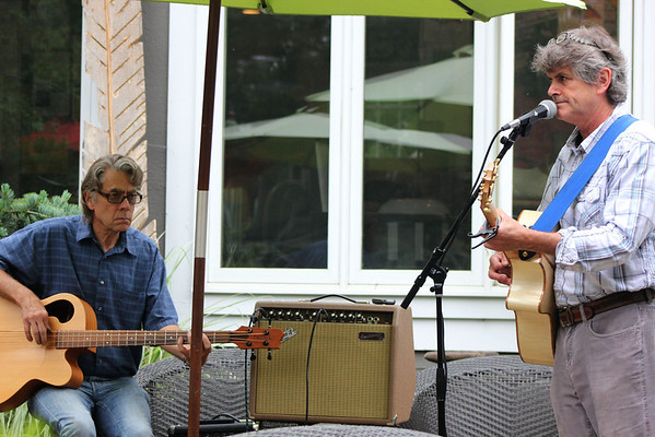 Dennis Lee, left, of St. Charles, and Dr. John Honey, right, of Geneva, entertain patrons of Graham's 318 Coffee House in downtown Geneva on Wednesday. Honey, when he isn't playing the guitar, runs the Fox Valley Wellness Center in St. Charles, and is the oldest chiropractor/acupuncturist in Kane County. He plays the guitar at Graham's every Wednesday, frequently playing with other artists such as Lee.