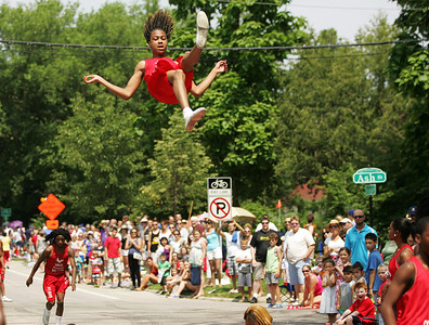 Kyle Grillot - kgrillot@shawmedia.com   Marquis Hotkins with  the Jesse White Tumblers flies throughout the air during the Annual Independence Day Parade Sunday, July 7, 2013 in Crystal Lake. Over 100 different groups participated in the parade from City Hall to the Lakeside Festival.