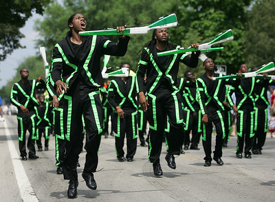 Kyle Grillot - kgrillot@shawmedia.com   Members of the South Shore Drill Team perform on Dole Avenue during the Annual Independence Day Parade Sunday, July 7, 2013 in Crystal Lake. Over 100 different groups participated in the parade from City Hall to the Lakeside Festival.