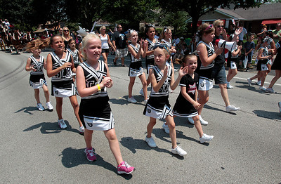 Kyle Grillot - kgrillot@shawmedia.com   The Crystal Lake Raiders Sparkle Cheerleaders advance on Dole Avenue during the Annual Independence Day Parade Sunday, July 7, 2013 in Crystal Lake. Over 100 different groups participated in the parade from City Hall to the Lakeside Festival.