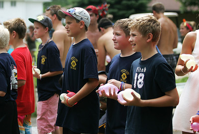 Kyle Grillot - kgrillot@shawmedia.com   Spectators wait for the end of the Annual Independence Day Parade before starting an annual water balloon fight held between neighbors on Dole Avenue Sunday, July 7, 2013 in Crystal Lake. Over 100 different groups participated in the parade from City Hall to the Lakeside Festival.