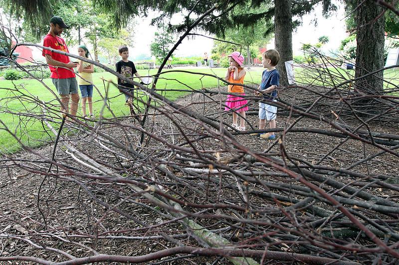 Jeff Krage – For Shaw Media<br /> Children gather inside the bird nest during Wild Saturday at Peck Farm Park in Geneva.<br /> Geneva 7/6/13