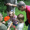 Barb McKittrick, a naturalist with the Forest Preserve District of Kane County, shows a captured moth to Grace Vanderheyden, 5, of Sugar Grove and Sam Strecher, 4, of St. Charles, during a butterfly hunt at the Dick Young Forest Preserve in Batavai on Saturday. Kane County has over 20 different species of butterflies, some of which look similar to moths.
