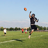 Jeff Krage – For Shaw Media<br /> St. Charles East's Alex Abate fails to make a catch during Wednesday's 7-on-7 against East Aurora at St. Charles East High School.<br /> St. Charles 7/10/13