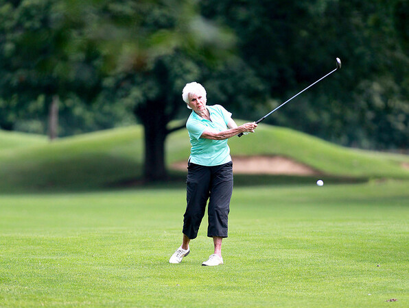 Barb Lyon of St. Charles hits from the fairway during the St. Charles Women's Tournament at Pottawatomie Golf Course in St. Charles Tuesday morning.