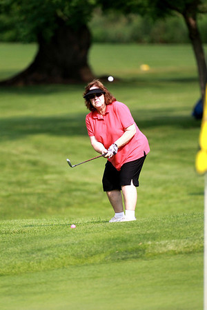 Connie Wagner of Geneva hits onto the green during the St. Charles Women's Tournament at Pottawatomie Golf Course in St. Charles Tuesday morning.