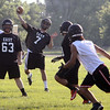 Jeff Krage – For Shaw Media<br /> St. Charles East quarterback Jimmy Mitchell passes the football during Wednesday's 7-on-7 against East Aurora at St. Charles East High School.<br /> St. Charles 7/10/13