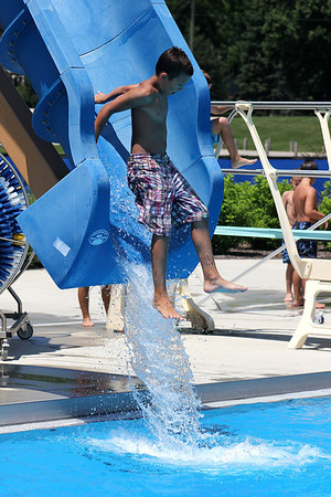 Ryan Schlorf, 10, of Downers Grove, exits the drop slide with a splash at Otter Cove Aquatic Park on Wednesday afternoon. Temperatures in the mid-80s brought many patrons to Otter Cove to try and beat the heat.