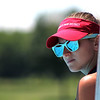 Paige Jordan of St. Charles, a lifeguard at Otter Cove Aquatic Park in St. Charles, keeps an eye on swimmers leaving the diving board area on Wednesday. Jordan, who started as a lifeguard two months ago, said that inclement weather had kept many guests away, but higher temperatures this week brought back crowds.