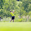 Spencer Sharpe of Geneva hits from the fairway during the second round of the IJGA-CDGA Junior Amateur tournament at Mill Creek Golf Course in Geneva Thursday morning.
