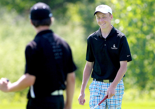 Brett Hassels of Geneva smiles after sinking a birdie on the 13th hole during the second round of the IJGA-CDGA Junior Amateur tournament at Mill Creek Golf Course in Geneva Thursday morning.