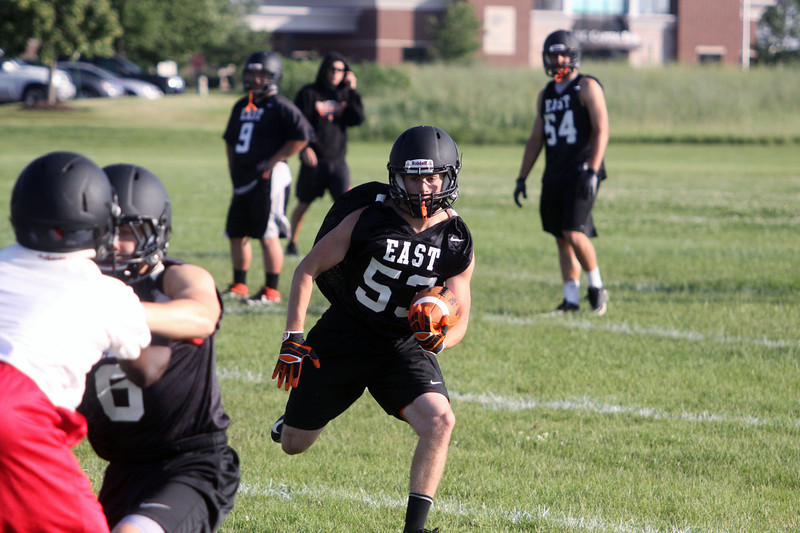Jeff Krage – For Shaw Media<br /> St. Charles East's Matt Arvizu carries the football during Wednesday's 7-on-7 against East Aurora at St. Charles East High School.<br /> St. Charles 7/10/13