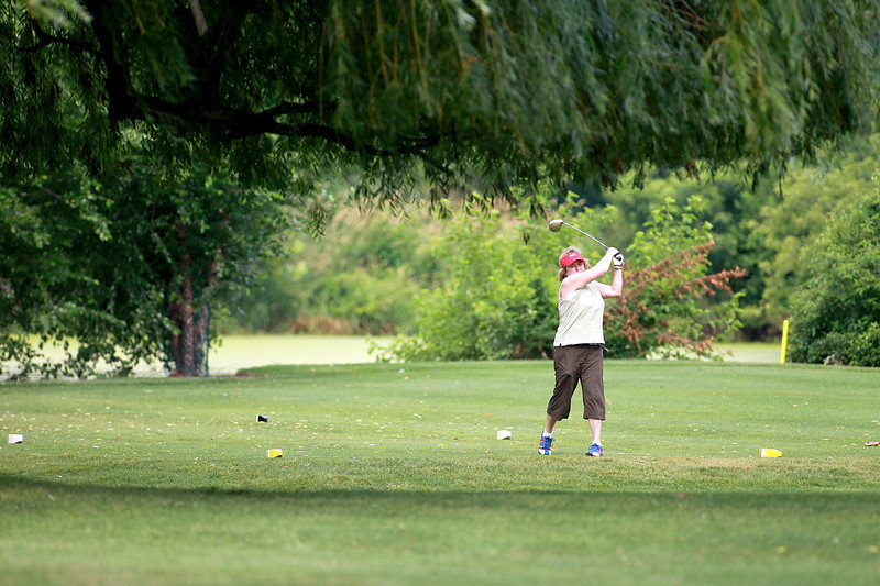 Wendy Mossier of St. Charles hits from the fairway during the St. Charles Women's Tournament at Pottawatomie Golf Course in St. Charles Tuesday morning.