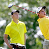 Andrew Sherman of St. Charles tees off as Spencer Sharpe of Geneva looks on during the second round of the IJGA-CDGA Junior Amateur tournament at Mill Creek Golf Course in Geneva Thursday morning.