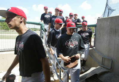 H. Rick Bamman - hbamman@shawmedia.com The Huntley Red Raiders return to the dugout after warm ups before played the Lawler Summer Classic at Benedictine University in Lisle Monday, July 22, 2013.