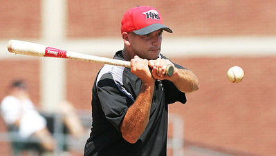 H. Rick Bamman - hbamman@shawmedia.com Huntley Red Raiders head coach Andy Jakubowski hits fungos during warm-ups before the Illinois High School Coaches Association's Lawler Sumer Classic at Benedictine University in Lisle Monday, July 22, 2013.