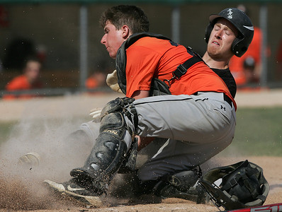 H. Rick Bamman - hbamman@shawmedia.com Huntley's Brendon Fitzgerald (right) is tagged out at home by Libertyville's Ryan Jackson in the bottom of the fifth inning during the Lawler Sumer Classic at Benedictine University in Lisle Monday, July 22, 2013.