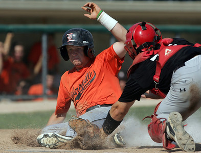H. Rick Bamman - hbamman@shawmedia.com Libertyville's Sean Ferraro is safe at home betting the tag by Huntley's Mark Skonieczny in the fifth inning during the Lawler Sumer Classic at Benedictine University in Lisle Monday, July 22, 2013.