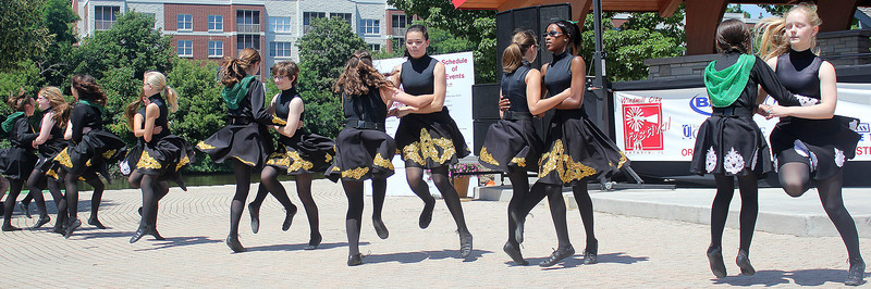 Students of the Weber School of Irish Dance entertain the crowd with a combination of traditional Irish dances during an expose at the Windmill City Festival in downtown Batavia on Saturday. The Weber School of Irish Dance is one of the most famous Irish Dance schools in the Chicagoland area, and has been open for over 40 years.