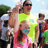 Brookelyn VandeLoo, 5, of Batavia raises her hand in triumph after winning the ice cream eating contest for ages 6 and under during the Windmill City Festival Sunday in downtown Batavia.