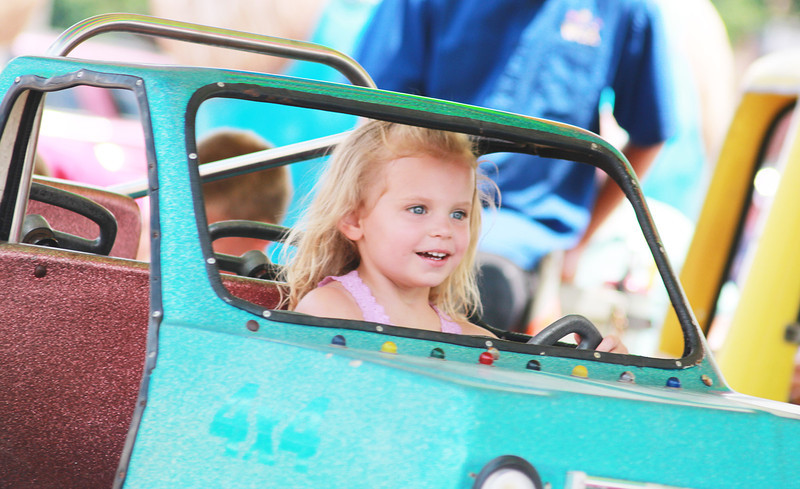 Georgia Dieter, 3, of Naperville enjoys the Windy City Amusement rides during the Windmill City Festival Sunday in downtown Batavia.